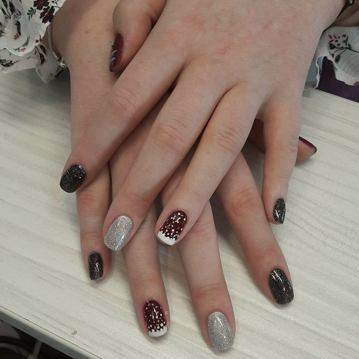 hand with sparkly nail polish