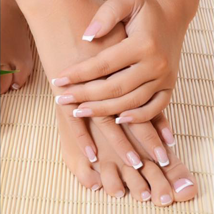 hands and feet with french tip nail polish